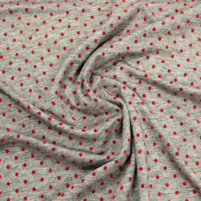 Tissu gris plumetis rouge