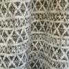 Tissu jersey maille lurex géométrique - noir x 10 cm