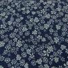 Tissu denim stretch imprimé fleurs - bleu x 10 cm