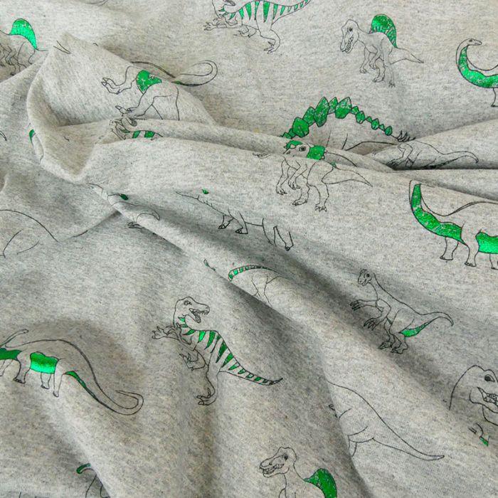 Tissu jersey dinosaures vert lurex - gris x 10 cm