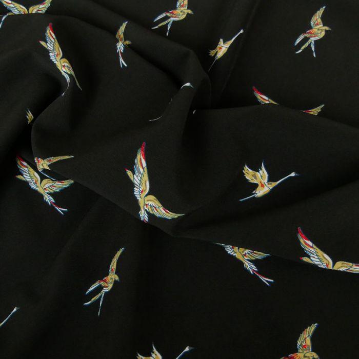Tissu crêpe polyester grues - noir x 10 cm
