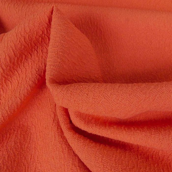Tissu polyester texturé corail - orange x 10 cm