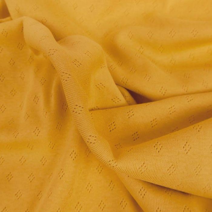 Tissu jersey ajouré - moutarde x 10 cm