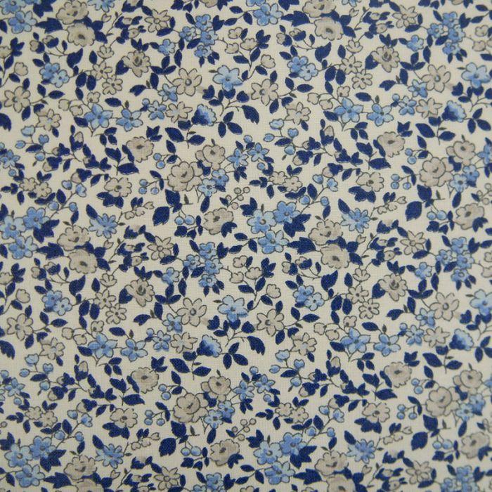 Tissu coton enduit fleurs - bleu blanc x 10 cm