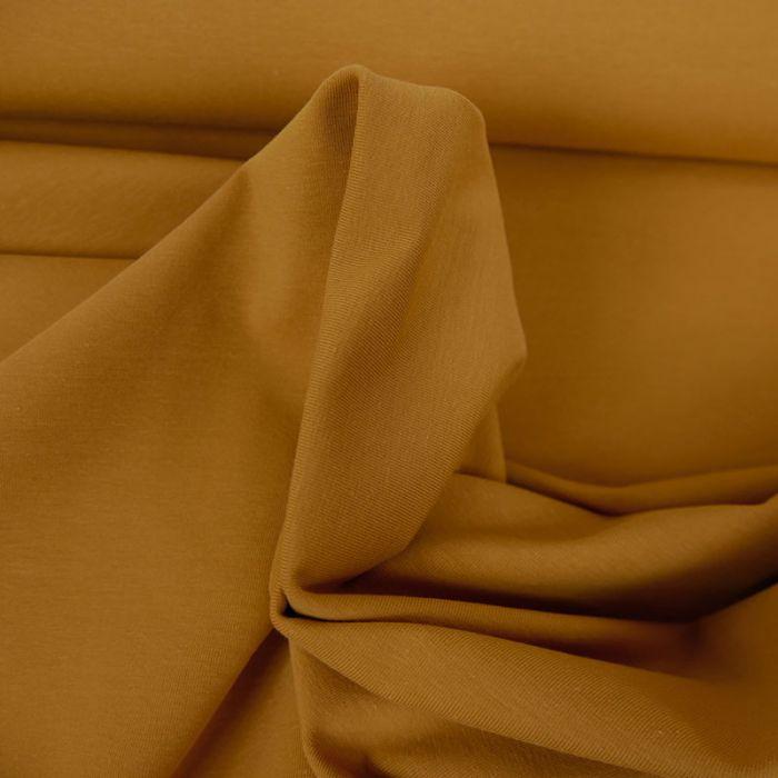 Tissu jersey coton uni ocre x 10cm