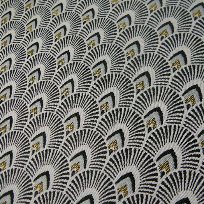 Tissu jacquard écailles - noir or x 10 cm