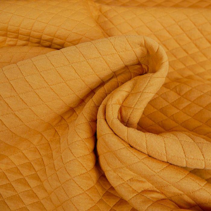 Jersey matelassé coton - curcuma x 10 cm