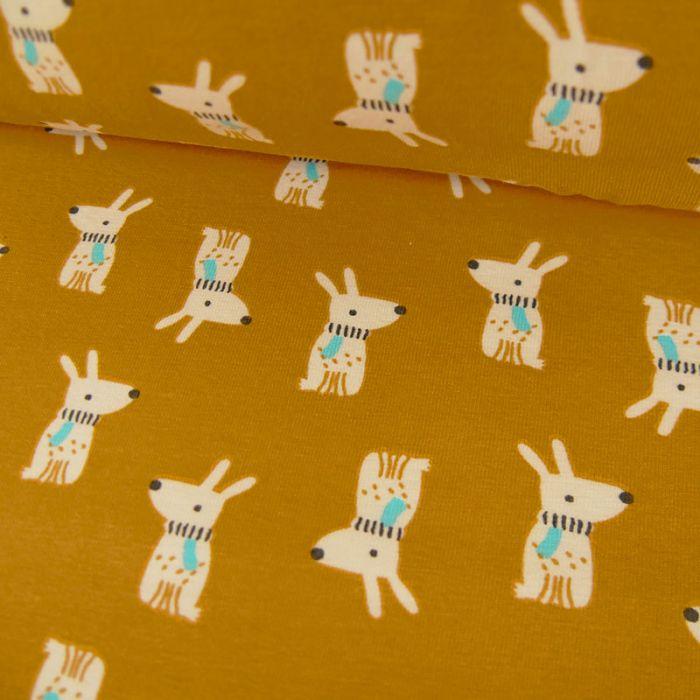 Tissu jersey coton chiens - moutarde x 10cm