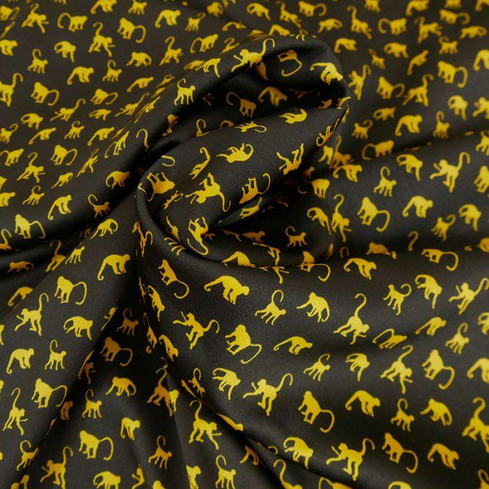 Tissu polyester singes jaunes - noir x 10 cm