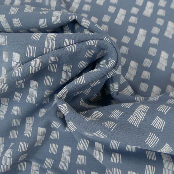 Tissu molleton fin graphique - bleu x 10 cm