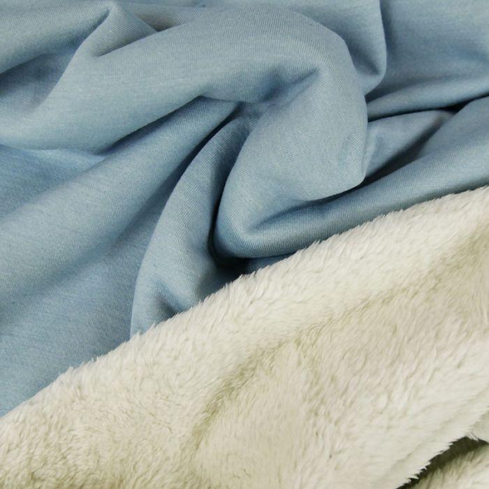 Tissu sweat envers fourrure mouton - bleu clair x 10 cm