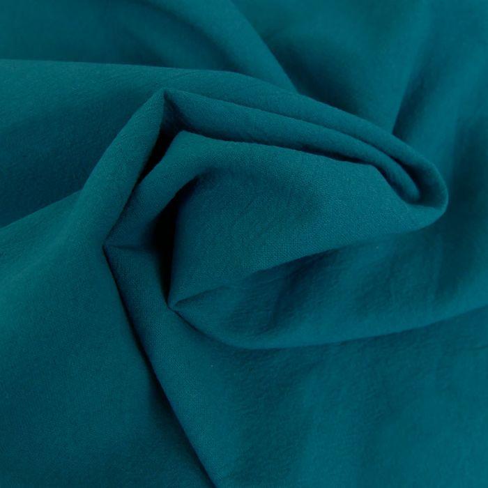 Tissu coton lavé uni - bleu paon x 10 cm