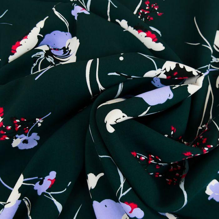 Tissu viscose fleurs blanches - vert foncé x 10 cm