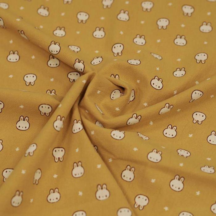 Tissu coton lavé lapins - moutarde x 10 cm