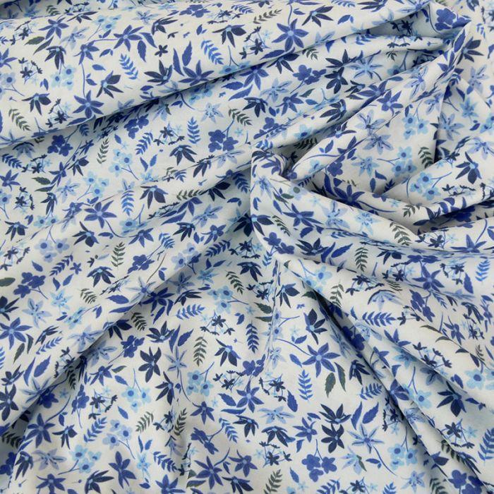 Tissu batiste coton feuilles bleues - blanc x 10 cm