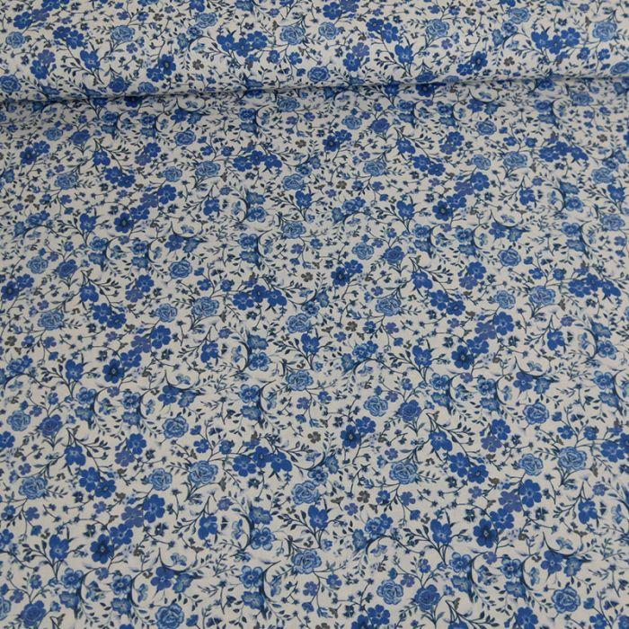 Tissu batiste coton fleurs bleues - blanc cassé x 10 cm