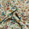 Tissu voile coton bouquets fleurs - blanc cassé x 10 cm