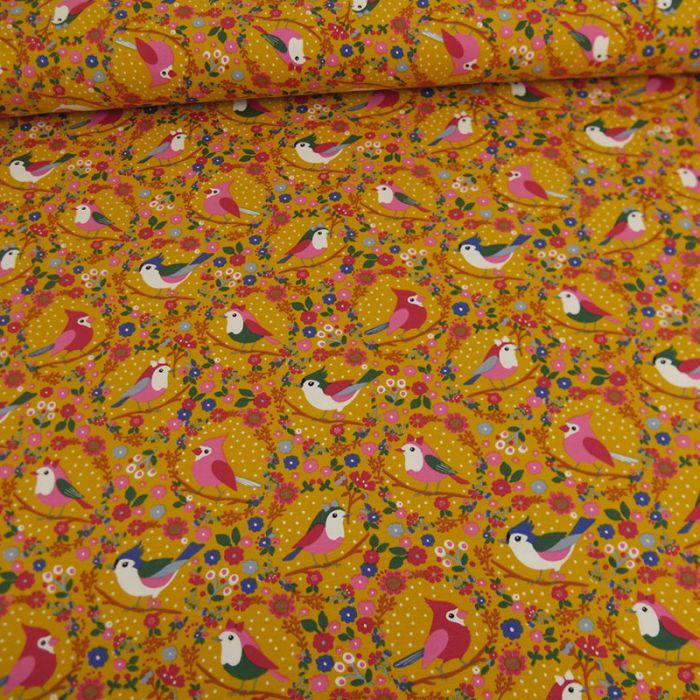 Tissu jersey oiseaux - moutarde x 10 cm