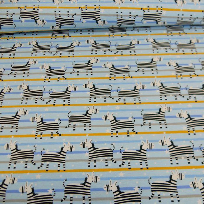 Tissu jersey zèbres - bleu clair x 10 cm