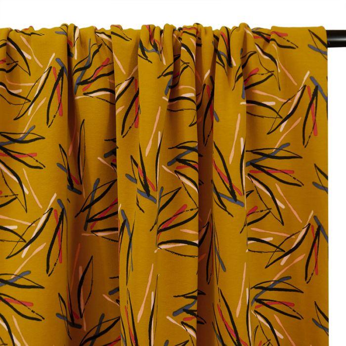 Tissu jersey sweat léger palmes - ocre x 10 cm