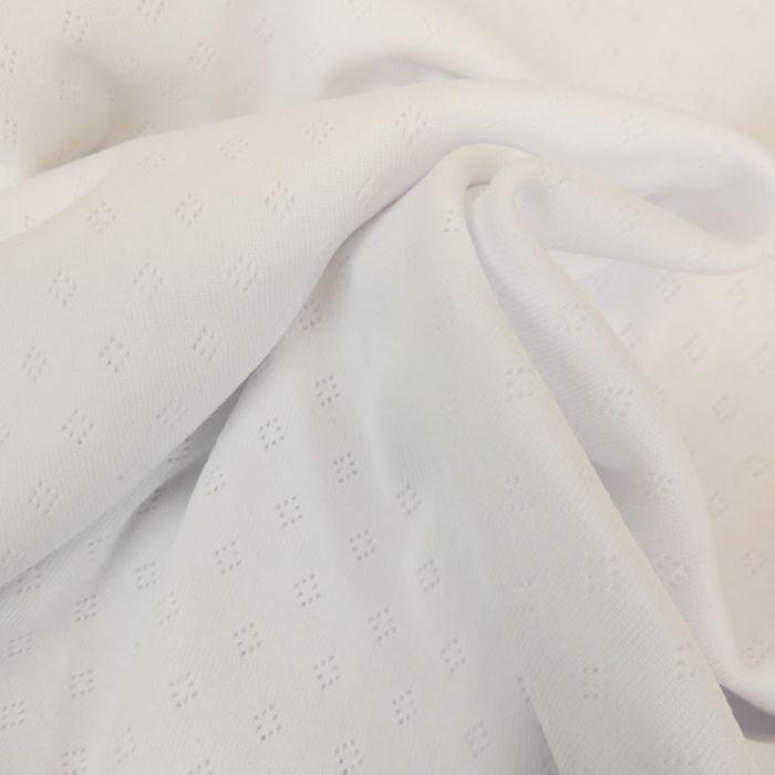 Tissu jersey ajouré - blanc x 10 cm