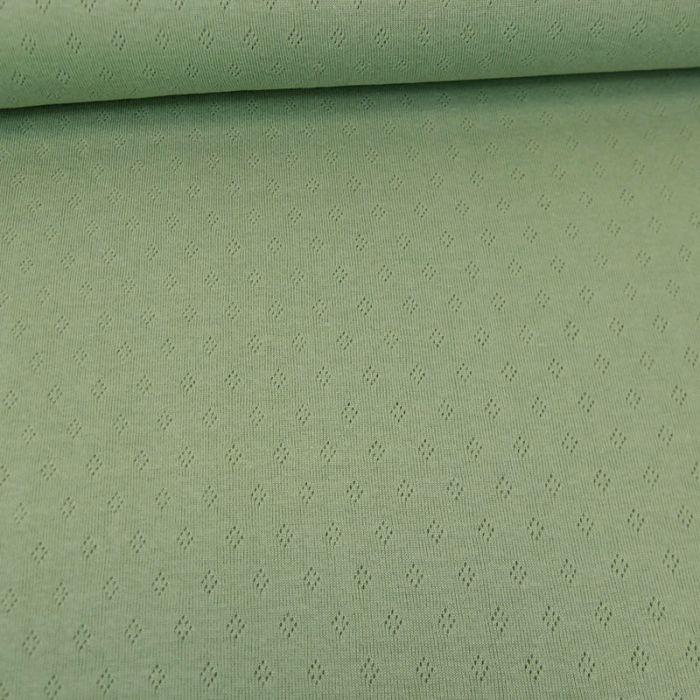 Tissu jersey ajouré - vert amande x 10 cm