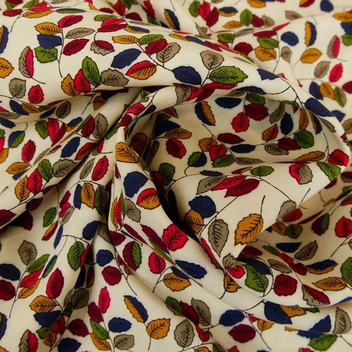 Tissu viscose feuilles automnales - écru x 10 cm