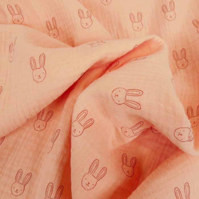 Tissu double gaze têtes de lapins - saumon x 10cm