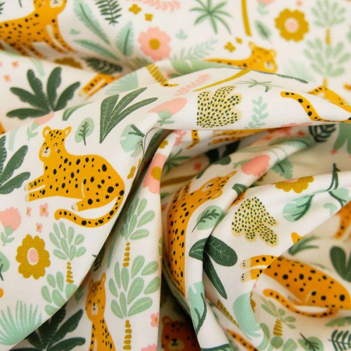 Tissu jersey jungle léopard - blanc x 10 cm