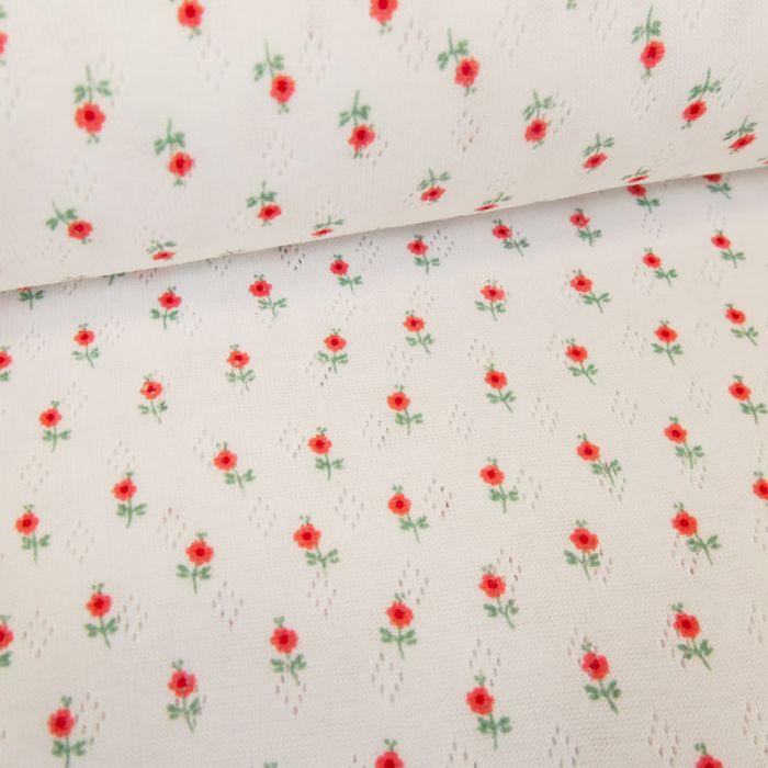 Tissu jersey ajouré fleurs - blanc x 10 cm