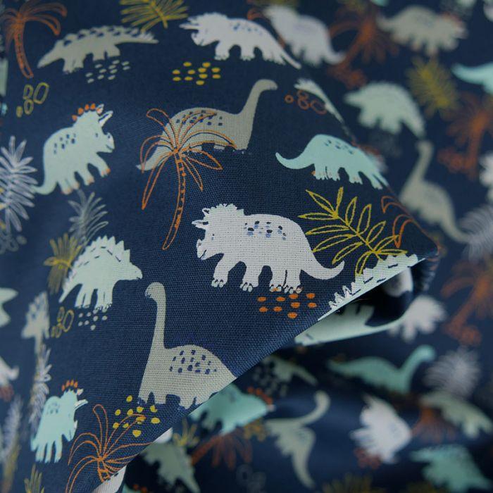 Tissu popeline de coton dinosaures - bleu marine x 10 cm