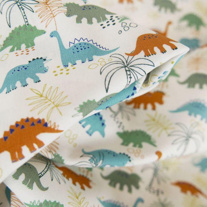 Tissu popeline de coton dinosaures - blanc cassé x 10 cm