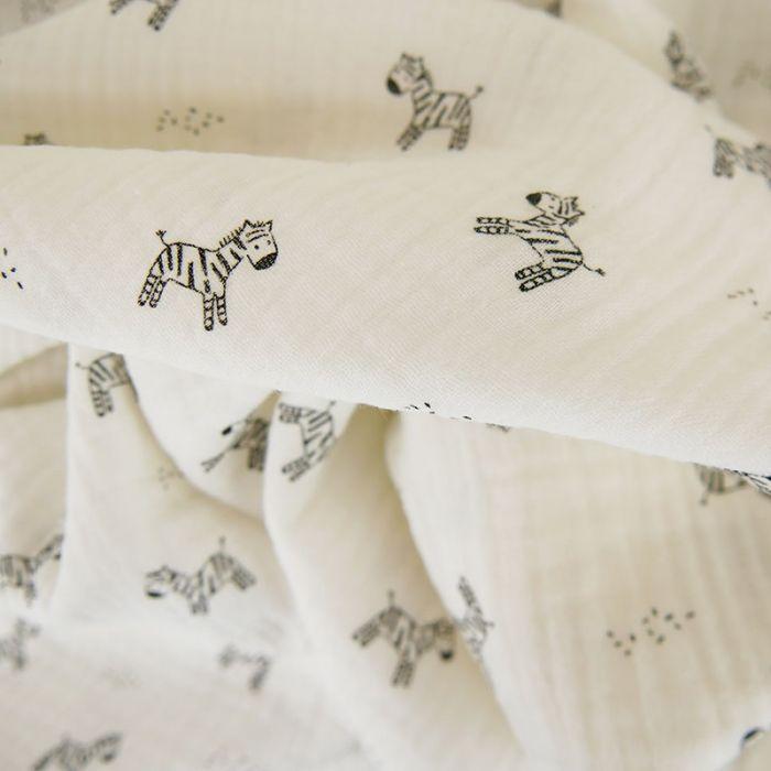 Tissu double gaze zèbres - blanc x 10cm