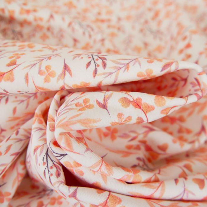 Tissu jersey fin feuilles orange - blanc cassé x 10 cm