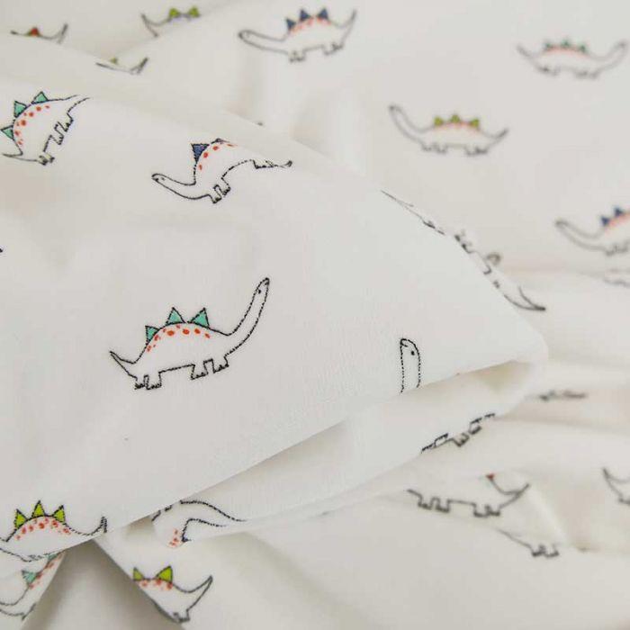 Tissu jersey pilou dinosaures - blanc  x 10 cm