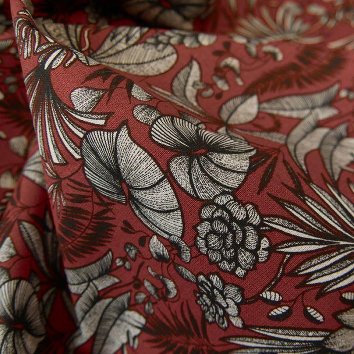 Tissu cretonne feuilles tropicales - rouge carmin x 10 cm