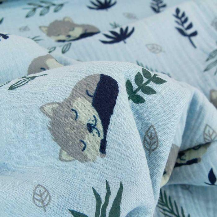 Tissu double gaze renards dormeurs - bleu layette x 10 cm