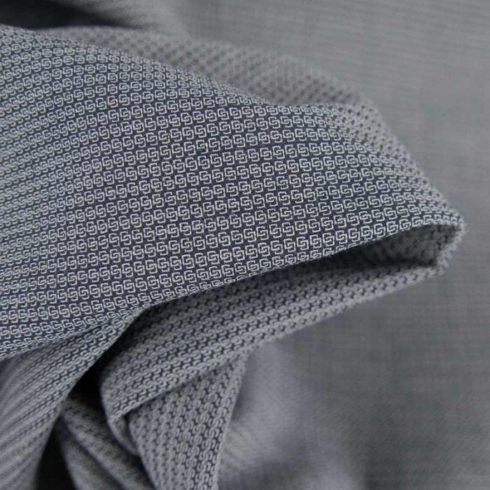 Tissu coton tissé cubes imbriqués haute couture - bleu marine x 10 cm