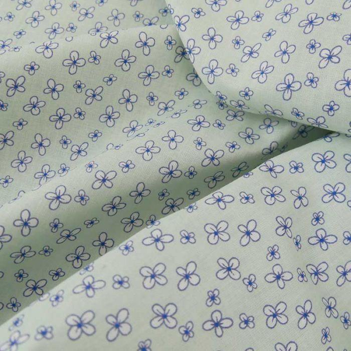 Tissu popeline coton fleurs cardamines - bleu pâle x 10 cm