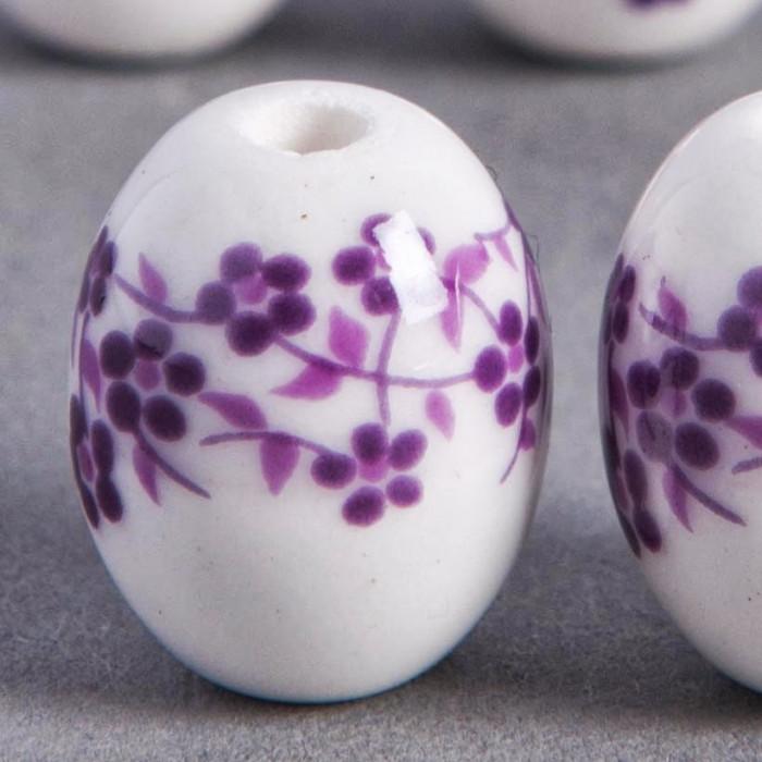 Perle en céramique Fleurie ovale violette 14mm x1