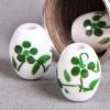 Perle en céramique Fleurie ovale verte 10mm x1