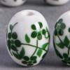 Perle en céramique Fleurie ovale verte 14mm x1