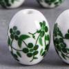 Perle en céramique Fleurie ovale verte 18mm x1