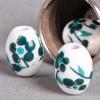 Perle en céramique Fleurie ovale Vert / Bleu foncé 10mm x1
