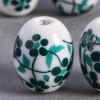 Perle en céramique Fleurie ovale Vert / Bleu foncé 14mm x1