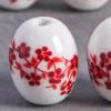 Perle en céramique Fleurie ovale rouge 14mm x1