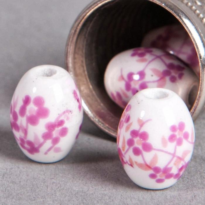 Perle en céramique Fleurie ovale rose 10mm x1