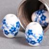Perle en céramique Fleurie ovale bleu roi 10mm x1