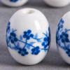 Perle en céramique Fleurie ovale bleu roi 14mm x1