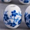 Perle en céramique Fleurie ovale bleu roi 18mm x1